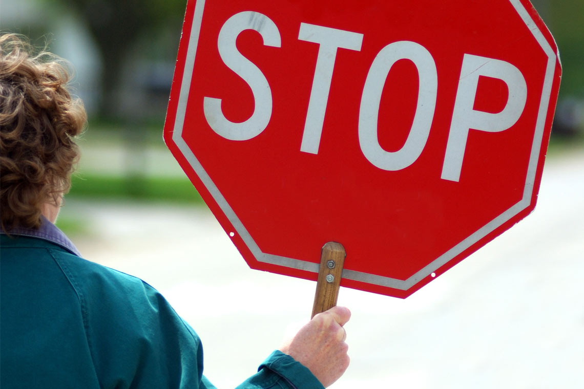 Crossing guard with sign