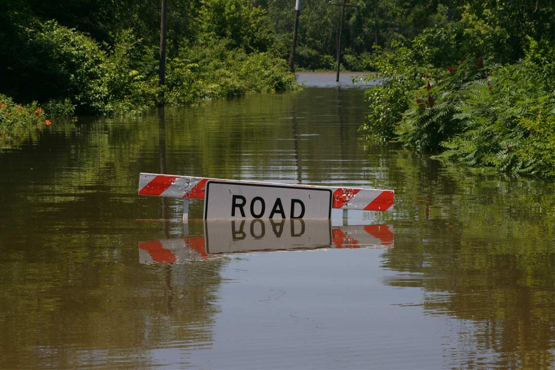 Flooded road with barricade