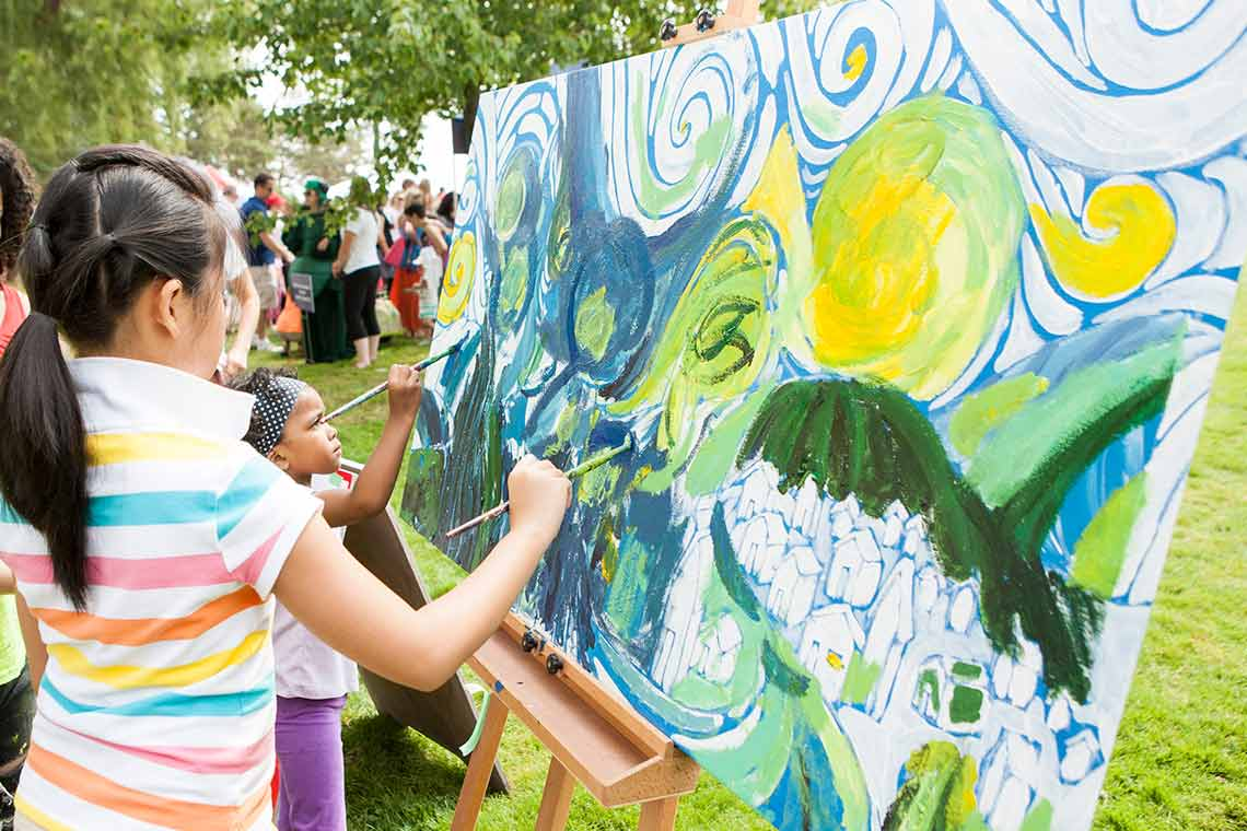 Children painting in the park