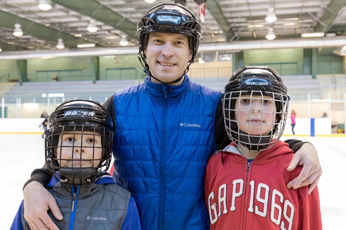 Family in hockey helmets