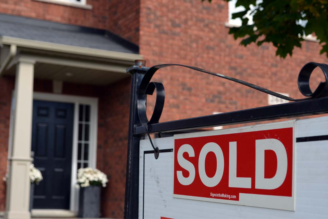 Sold sign in front of house